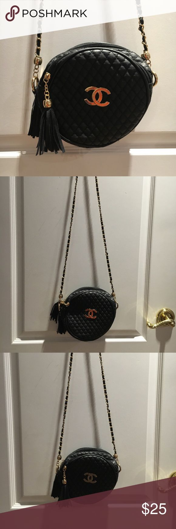 BLACK CHANEL PURSE black Chanel purse with fringe. Looks real but isn't. In perfect condition. Gold Chanel logo in middle. Long straps. Bags Crossbody Bags