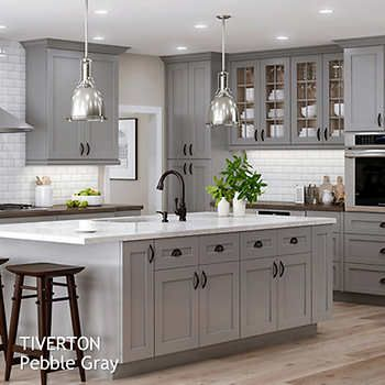 Crown Molding With Dark And Cream Alder Kitchen Cabinets