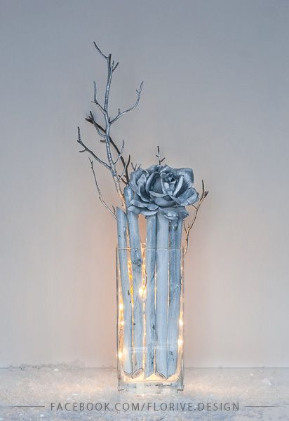 Silver Christmas decoration with fairy lights on the glass with fake snow