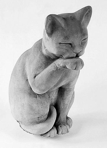 The Contented Cat Statue Licking His Paw With Beautifully Simple Lines Made  Of Cast Stone In The USA.