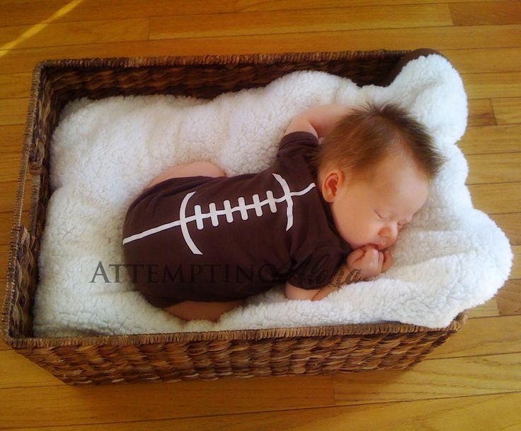 Ready for the Super Bowl! Make your own with a brown onesie and vinyl strips.