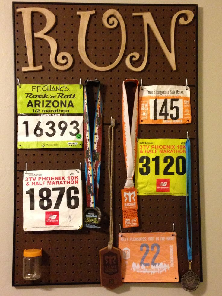 Creating a display for race bibs and medals using pegboard, and old frame, and pegboard hooks.