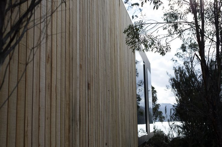 Jaws Architects have taken off-site prefabrication to a new level of refinement with the design and development of the latest additional to the unique Pumphouse Point premium accommodation experience. The building is built from weathered vertical timber boards and is perfectly nestled at the edge of the existing regenerated vegetation line.