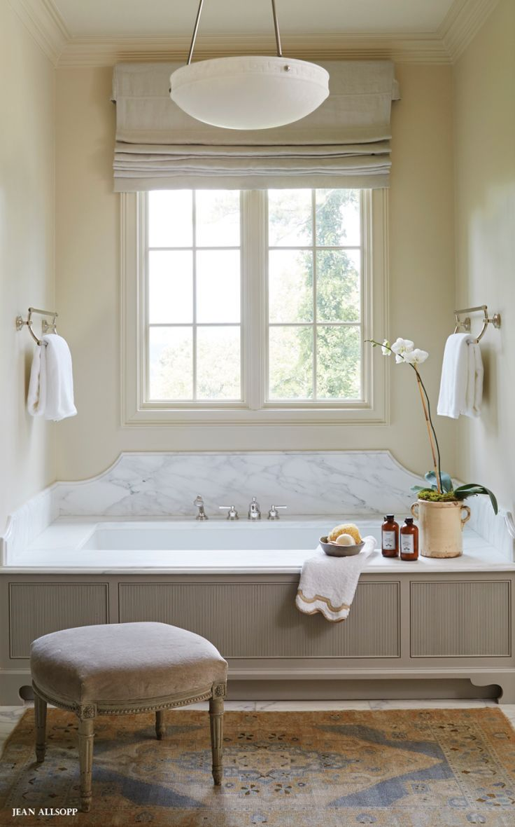Tub with custom cabinetry.