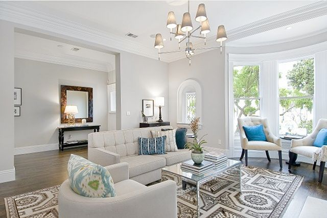 Wall color: Abalone 2108-60 by Benjamin Moore, trim color: Decorators White by BM. The light comes from Jonathan Adler, sofa is from Ken Fulk Design in SF.