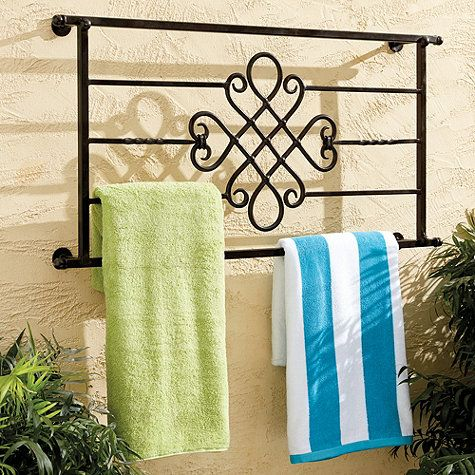 During pool season, this decorative Towel Rack holds plenty of towels. When the weather cools, enjoy the scrollwork as outdoor art. Frame is powder-coated to resist rust and stands off from the wall so towels dry faster. Outdoor Decorative Towel Rack features: Also great in laundry, bath or kitchenHandmade of ironTwisted details