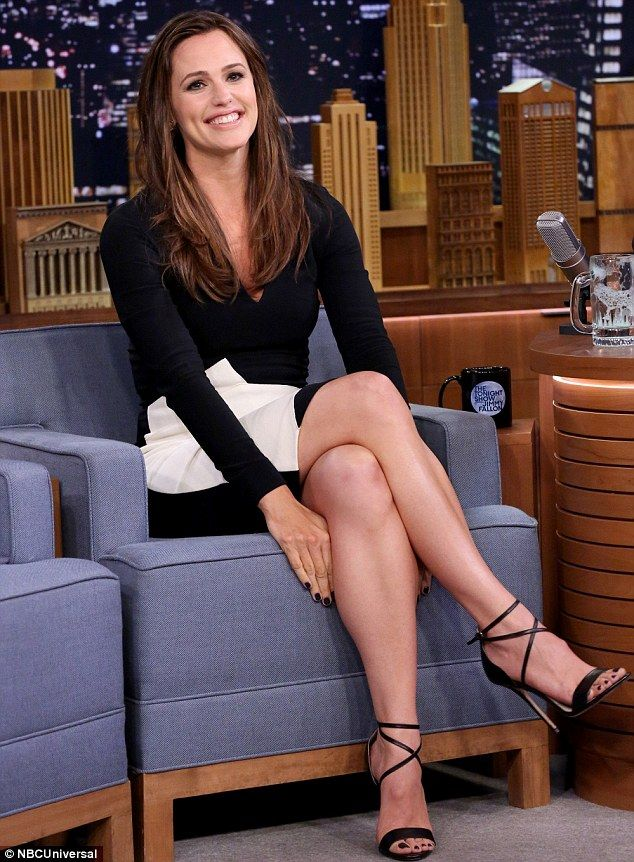 Stylish star: Jennifer looked chic dressed in a black and white Roland Mouret long sleeve ...