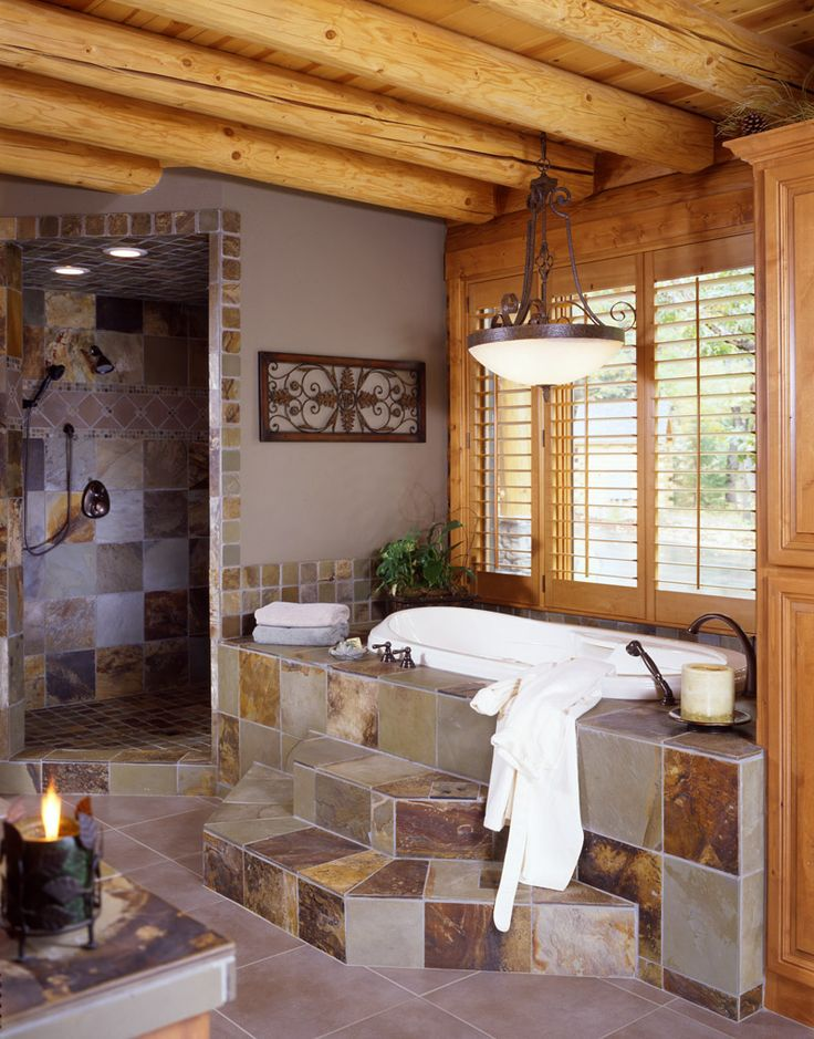 Stunning log cabin home stone shower and tub!!