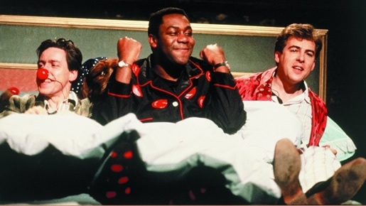 Griff Rhys Jones, Lenny Henry and Jonathon Ross make happy bedfellows during the show for Red Nose Day 1988.