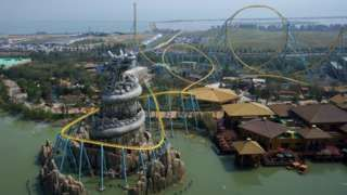 Image copyright                  AFP                                                     China's Dalian Wanda has stepped up competition with Walt Disney, opening yet another theme park in the country.  On Saturday, the company welcomed the first visitors to a new 34bn yuan ($5.1bn; £3.9bn) park in Hefei which also has hotels and a shopping mall.  The firm