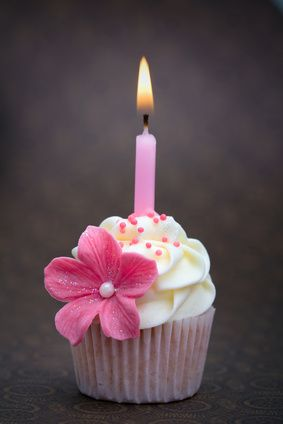 Love the flower on the side of this cupcake. It makes it special for just one individuals Special day and looks like a miniature cake.
