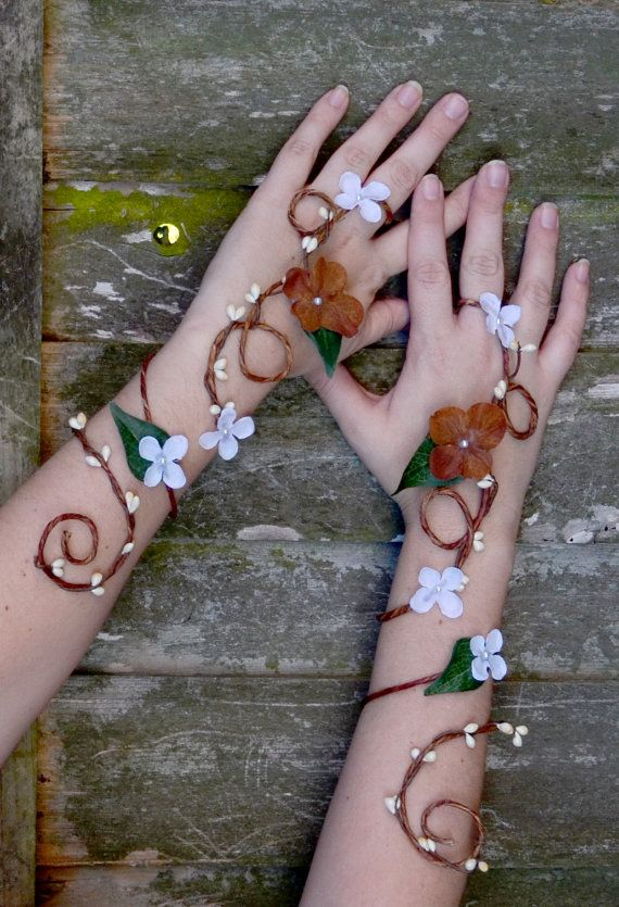 Cool arm cuffs https://www.etsy.com/listing/178821705/custom-fairy-arm-cuffs-bridal-accessory