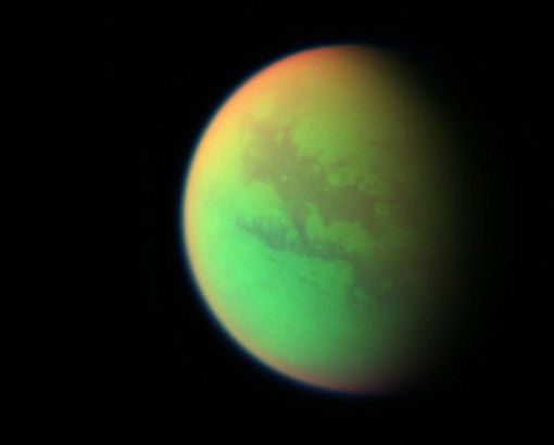 Moons of Saturn : Titan Discovery News Titan, mightiest of all the Saturn moons, a sort of early Earth chock full of organic compounds and a thick atmosphere. In January 2005, the Huygens probe landed on Titan's surface, revealing many of the orange-brown world's secrets. That makes Titan the only moon aside from Earth's to receive a robotic surface visit from humans. This false-color photo shows Titan's surface in green CREDIT: NASA/JPL/SPACE SCIENCE INSTITUTE