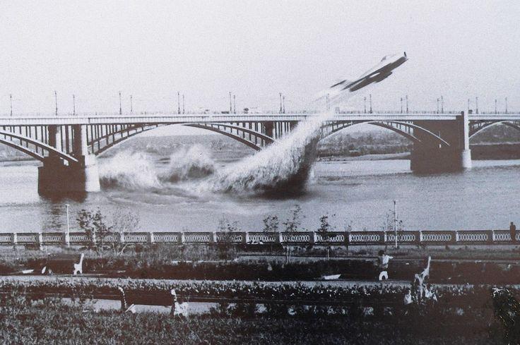 "historicaltimes: "" Soviet Air Force pilot Valentin Privalov flies his jet fighter under a bridge on the river Ob, in Siberia, June 4th, 1965. """