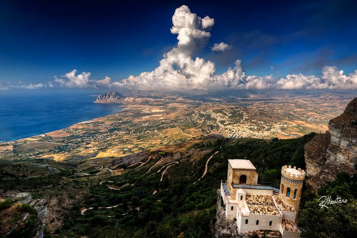 """Top of Erice  Follow my INSTAGRAM! Thanks! A trip in Sicily gave me the opportunity to visit the ancient city of Erice. From there, over 750mt above the sea level and thanks to a limpid day and to some clouds, it was possible to extend the view till the """"Punta del Saraceno"""" and to """"Capo San Vito"""" (behind). I had to wait that a sunray illuminated the small Castle on the lower right """"Torretta Pepoli"""", to shoot my photo. Hope I've got the effect I planned."""