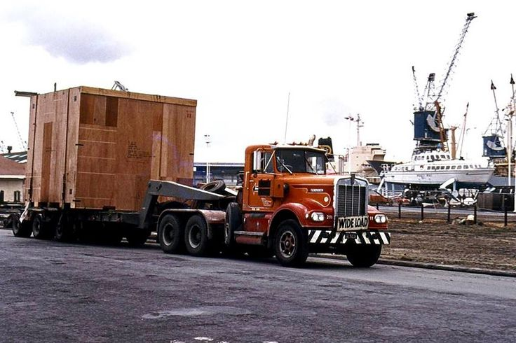 Bill ✔️ 1976. A Freightways Heavy Haulage, early Kenworth (fleet #212) with a very home made trailer, on Quay Street, Auckland, New Zealand. Note the hydrofoil Manu Wai in the background. Plagued by industrial disputes, the hydrofoil never ran in Auckland again.   Bill Gibson-Patmore.  (curation & caption: @BillGP). Bill✔️