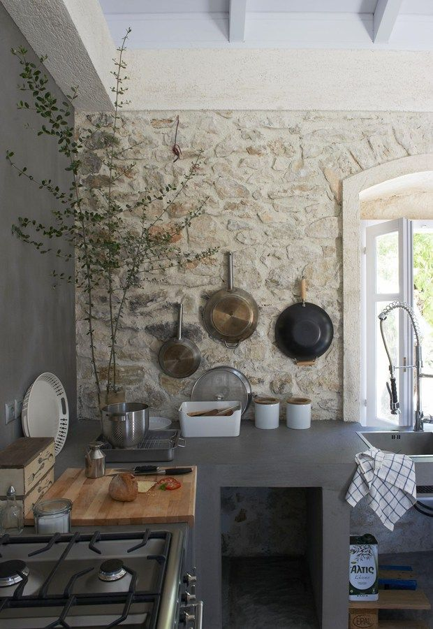 I like the different details: the stone wall, the hanging pans, and the darker color as contrast.