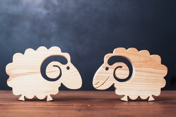 Cute wooden sheep will adorn your living space.