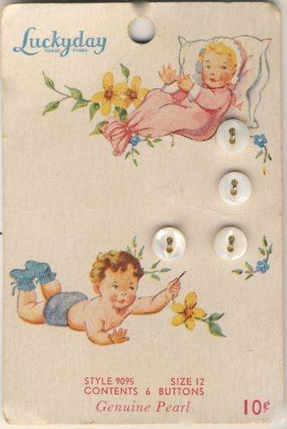 "(::) ""Luckyday"" genuine pearl buttons.  Vintage graphics of baby girl in her pink sacque, & baby boy wearing his booties... (neither of which require buttons!?)"