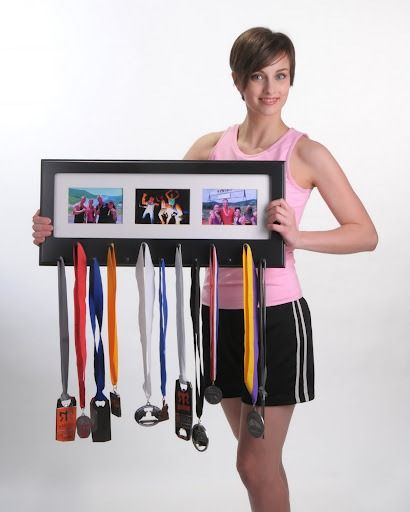 This is made to show off your race medals. Yeah, I ran once to catch a flight a few years ago... but it might just be the solution to my jumbled pile of necklaces! And I could put in cool pictures of the markets in Turkey and Bali where I got my favorites!