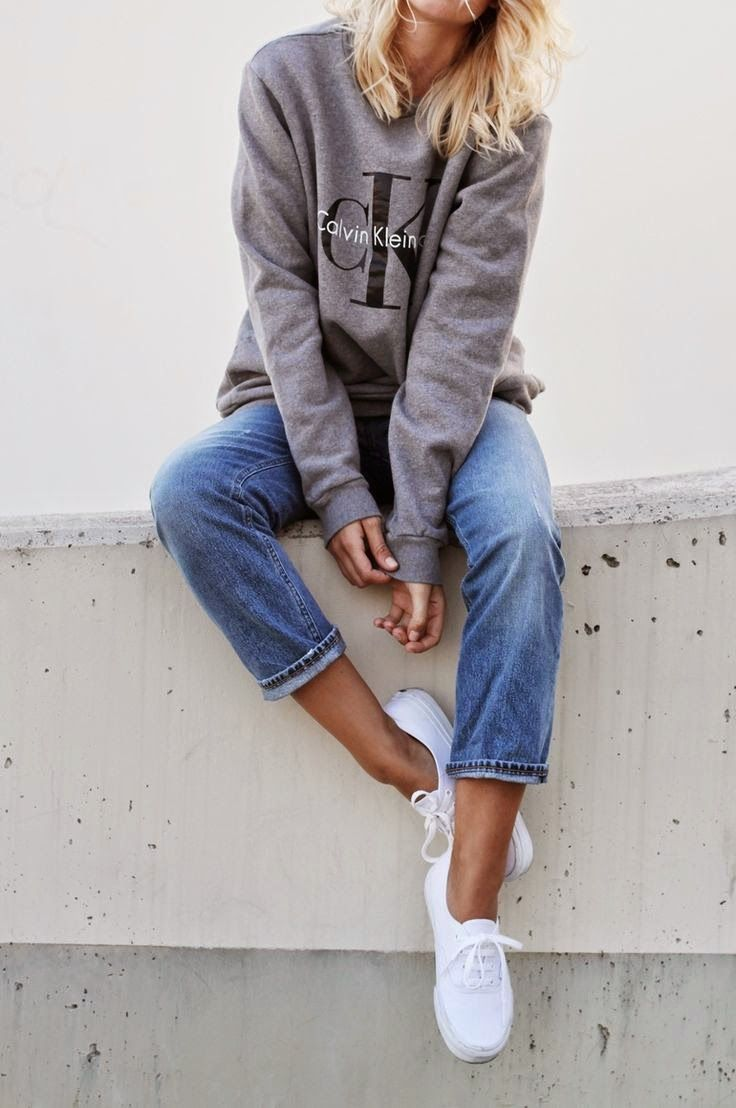 How casual Grey logo sweater from Calvin Klein, vintage jeans from Acne  Studios and white vans