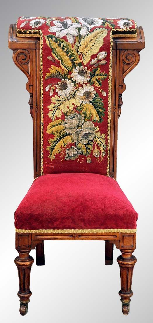 This is a beautiful Victorian needlepoint and crewel work-backed prayer bench with a solid black walnut deep frame dating from the 1880's.
