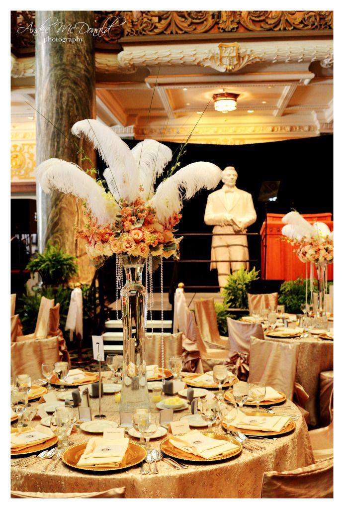 Beautiful Floral/Feather centerpiece by Flowers Squared
