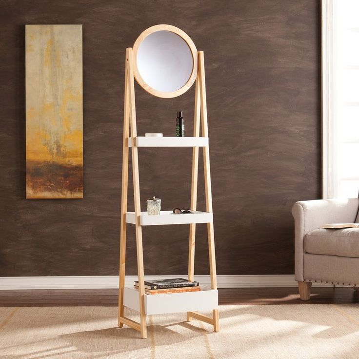 This hip, high contrast storage tower will frame your life with flair. A lovely A-frame in natural oak and three crisp white shelves keep makeup, jewelry, and accessories organized.  For added luxury, a vanity mirror spins 360 degrees, ensuring your look is perfect at every angle. This midcentury modern inspired, Scandinavian style piece is ideal for placement in the closet, dressing area, or hallway.
