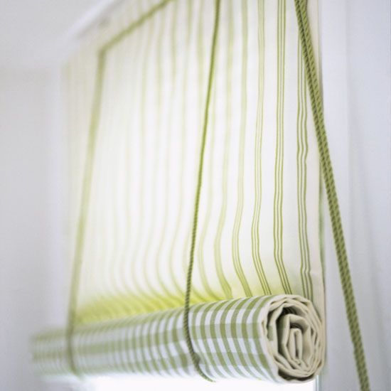Make a roll-up blind; DIY instructions at the site.  These would be good on my kitchen clerestory windows, because I can control the length of them.