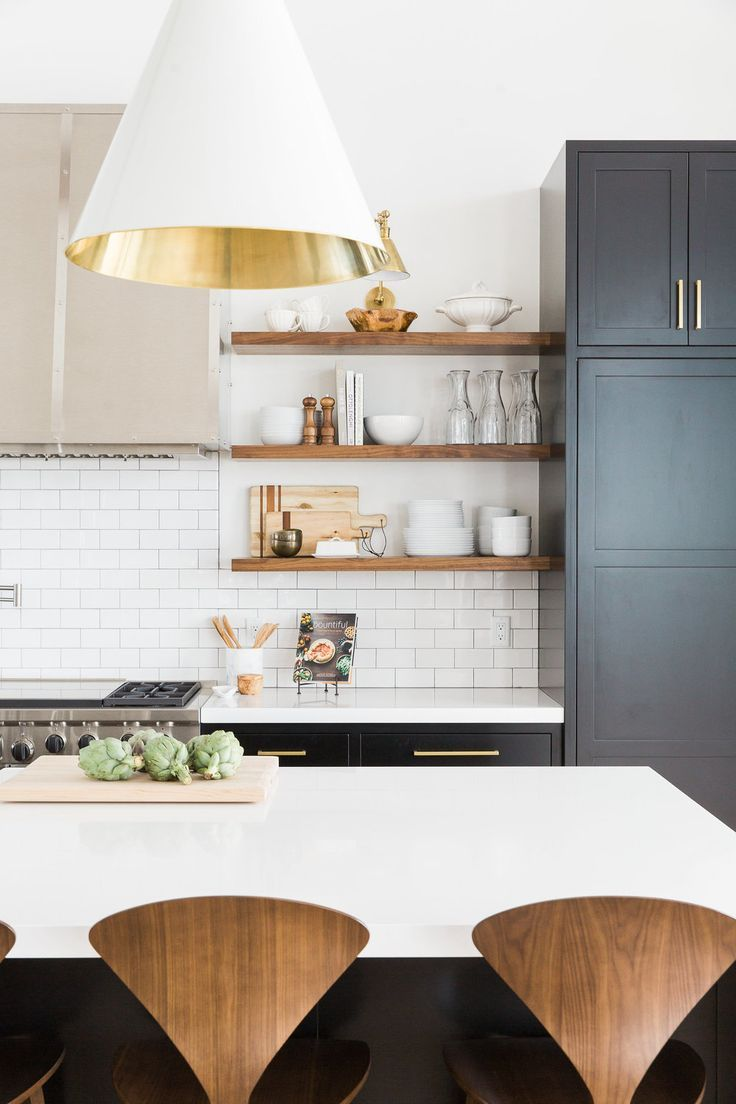 Beautiful black white and wood kitchen: floating walnut open shelving, wood counter stools, white counters, black cabinets - modern kitchen design with warmth and rustic touches