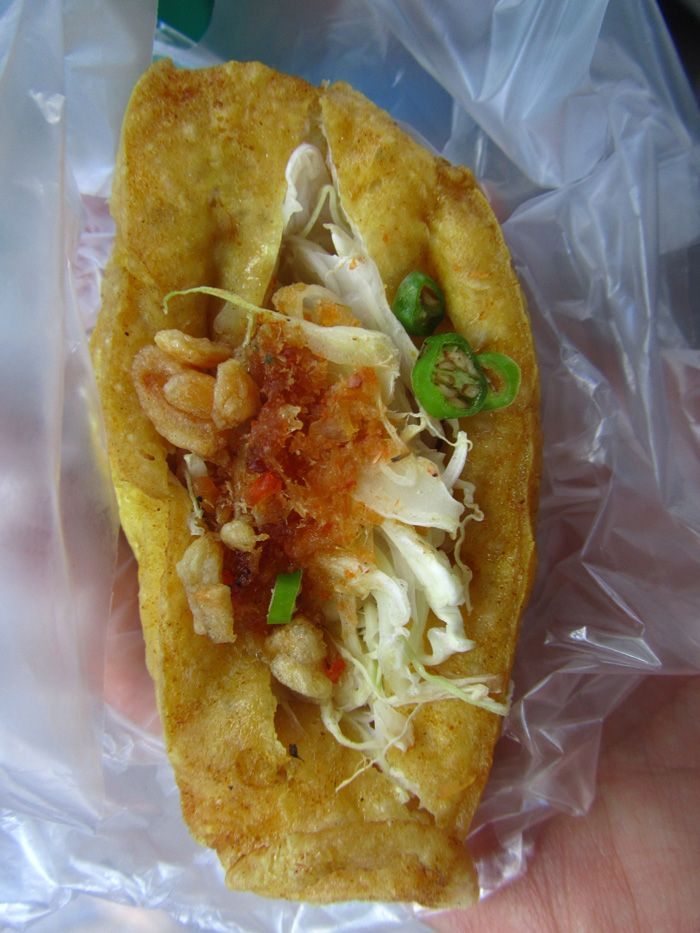 Burmese street food - deep fried Stuffed Tofu Roll with cabbage, chillies and sauces!