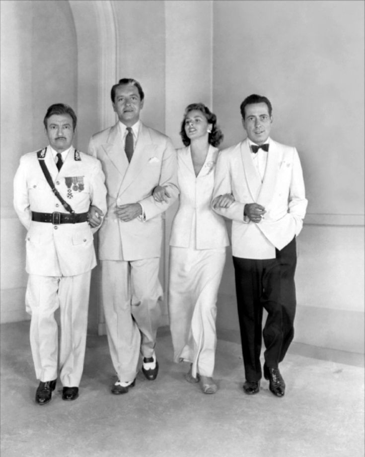 Claude-Raines-Paul-Henreid-Ingrid-Bergman-Humphrey-Bogart.jpg Why don't men wear dinner jackets any more????? and...I want her suit!