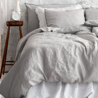 linen duvet cover set light gray love the ruffle on the white pillow case sneaky way to add more romance to a unisex room