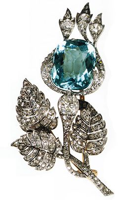Fabrege. This is one of the most spectacular Siberian Aquamarine jeweled pins designed by Faberge. It is in the motif of a thistle, the stem and leaves are paved in diamonds with the Aquamarine as the flower. Russians were proud to wear gems mined from their own mountains.