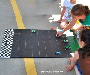cardboard race car game - use a dice to race cars to the finish line.