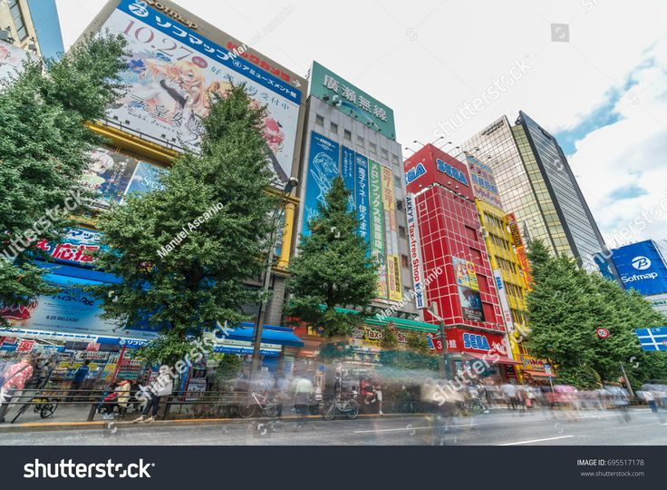 Tokyo, Taito-Ku, Akihabara - August 13, 2017 : Colorful Billboard Advertisements and Motion Blurred crowd in Akihabara Electric Town