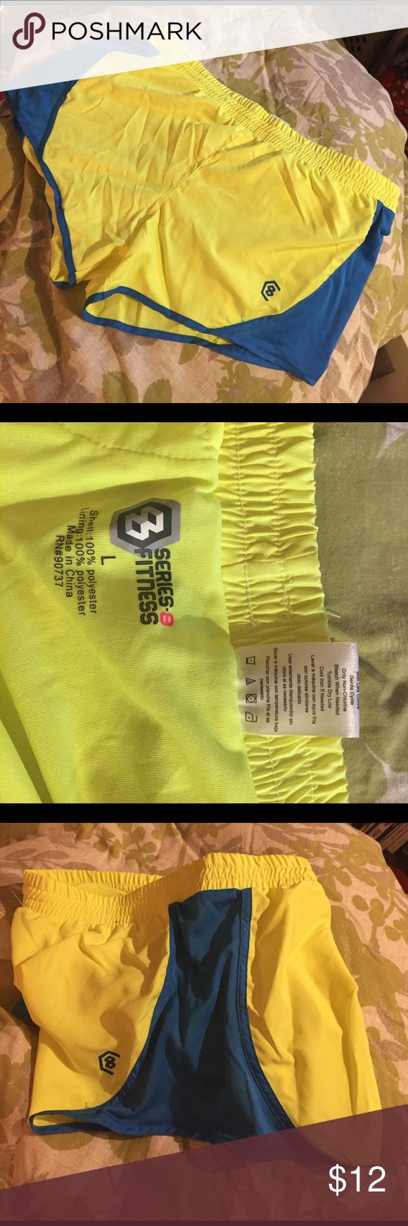 Yellow and blue workout shorts Neon yellow and blue work out shorts, never worn! Look like new series fitness Shorts