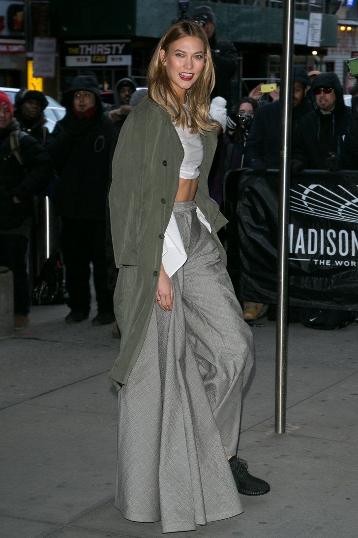Pin for Later: Catch Up on the Best Model Street Style Moments at MFW New York Fashion Week Karlie Kloss wearing a Rosie Assoulin look and Yeezy sneakers.