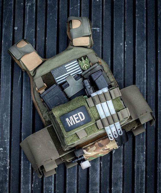 My minimalist plate carrier solution. Ferro Concepts Slickster in Ranger Green with Ferro Concepts shoulder pads. @spiritussystems Chest Rig Chassis rigged up with SwiftClip buckles. Coyote Tactical Solutions tourniquet holder. Running some Med gear...: