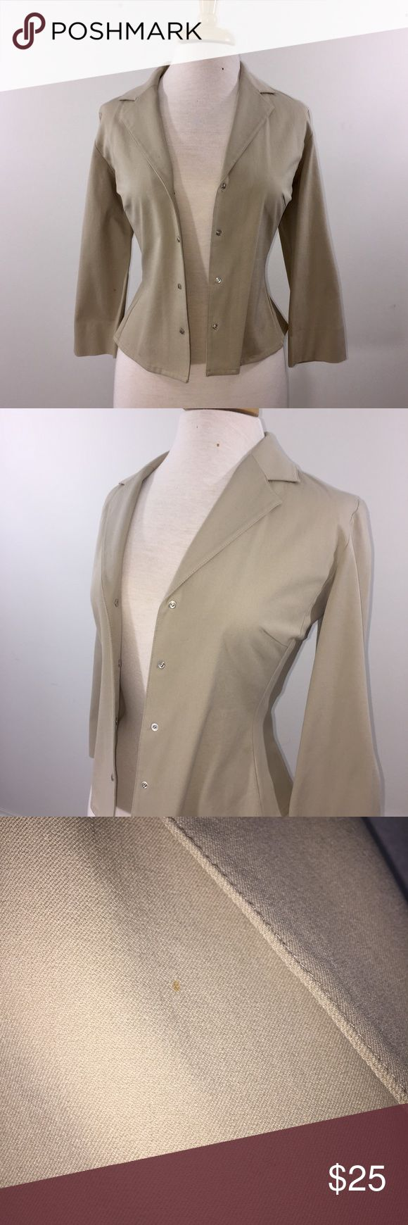 Khaki Colored Slimming Thalian Blazer Jacket This is a great khaki-colored blazer to add into your wardrobe! It is a slimming jacket with four silver Toned buttons snap shut.   Flattering cut & fabric has a stretch to it  There is a small spot on the right breast of the jacket (pictured). Only noticeable when looking for it - close enough to the collar that it nearly covers it. Minor flaw reflected in price.   Size 10 Thalian (purchased at Nordstrom) Originally $128 98% cotton 2% lycra…