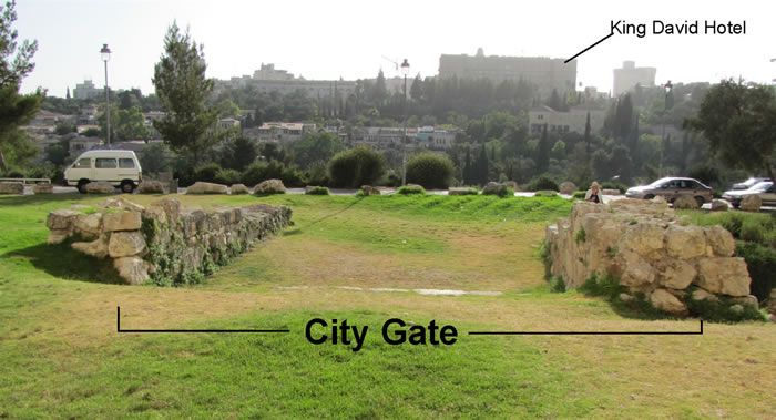 Herodian stones mark a west gate entrance into Herod's city by his palace from 20 BC. The top step of a wide staircase can be seen in the middle of the photo. The steps can be seen when viewed from the other direction. West Jerusalem and the beautiful modern King David Hotel is visible in the distance on the other side of the Hinnom Valley.