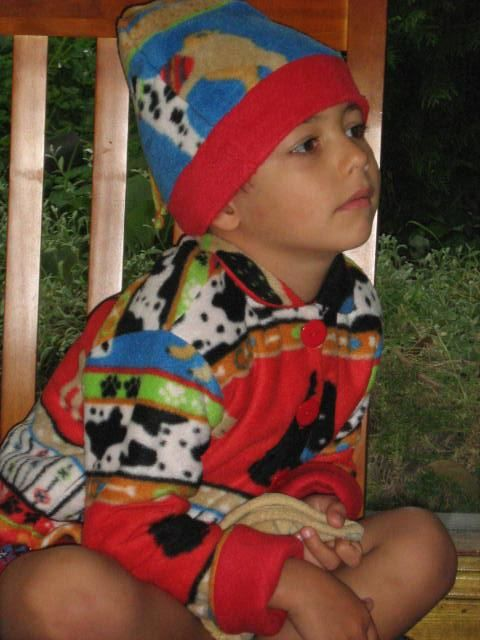 this Winter jacket and hat was made from a polo fleece blanket that cost $6.00 Amazing what you can do