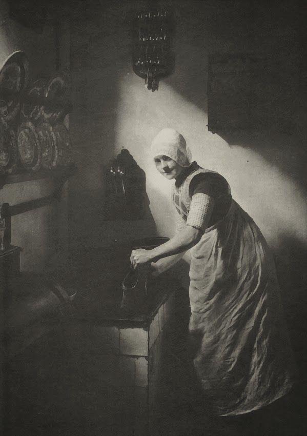 Girl washing her wooden shoes (Spakenburg 1920s) Photographer: Adriaan Boer, The Netherlands