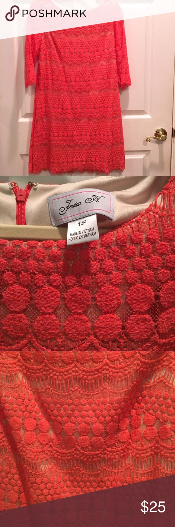 Coral Lace Dress 12p  EUC Coral lace dress with 3/4 sheer lace sleeves.  Body of dress is lined in nude fabric.  Scalloped clipped lace hem.  Dress made of 63% cotton 37% nylon.  Lining made of 100% polyester.  Size 12p.  Made by Jessica H.  EUC.  Only worn twice. Jessica H Dresses
