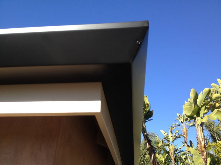 Black Angle Faced Rain Gutters on a white Fascia Board. Nice Contrast. This Home was in Costa Mesa California.