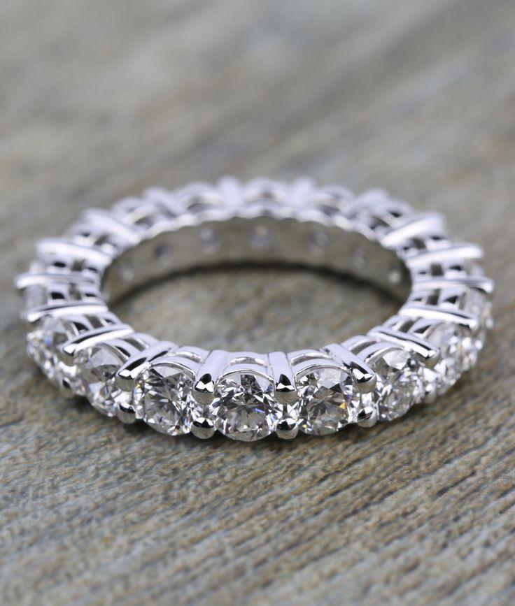 Another stunning Custom Shared-Prong Platinum Diamond Eternity Ring!