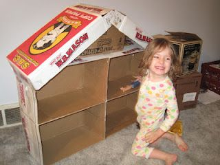 Barbie house made out of cardboard boxes