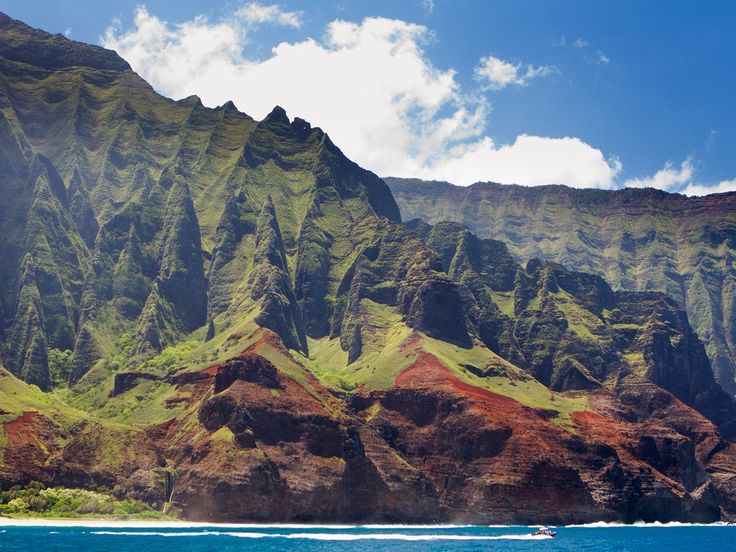 Kauai boasts one of the world's most insanely beautiful coastlines, which makes you work a bit to soak up its wonders—Na'Pali can only be seen from a helicopter, catamaran, or rather grueling hike.