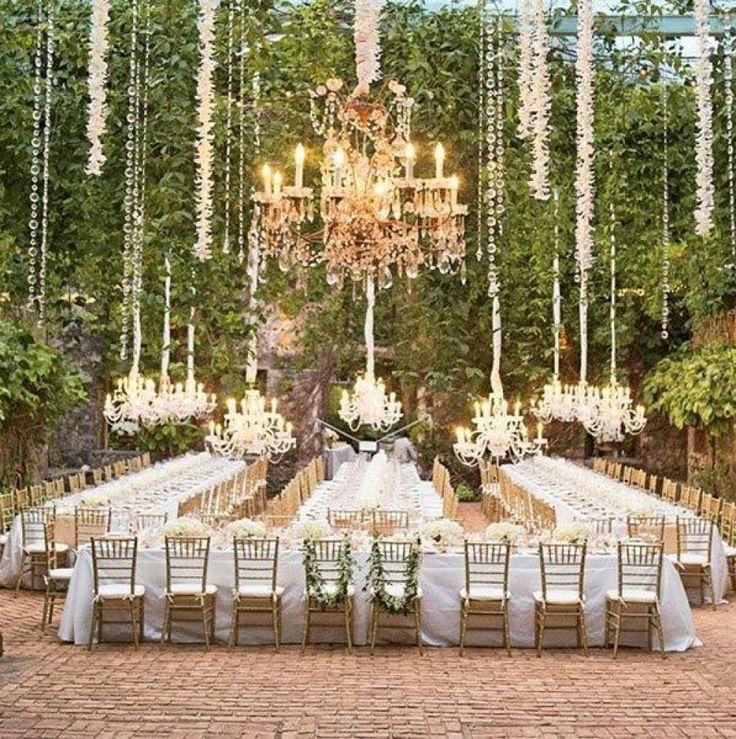 Create a regal atmosphere with long tables, gold chairs, and beautiful chandeliers | Aaron Delesie Photography