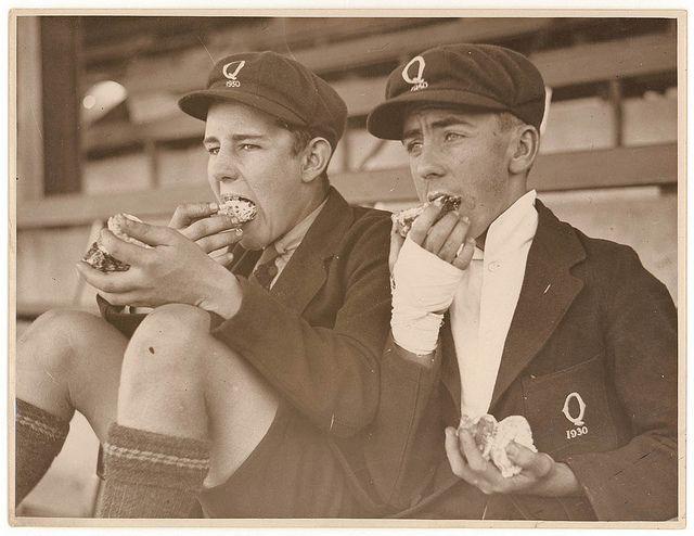 All sizes   Schoolboy fans eat cake, c. 1930, by Sam Hood, via Flickr.
